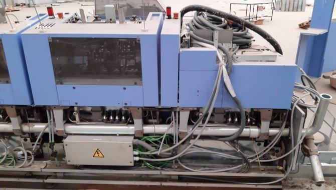 Foto - 01 Máquina automática para grampeação e corte trilateral de revistas e livros - [14]